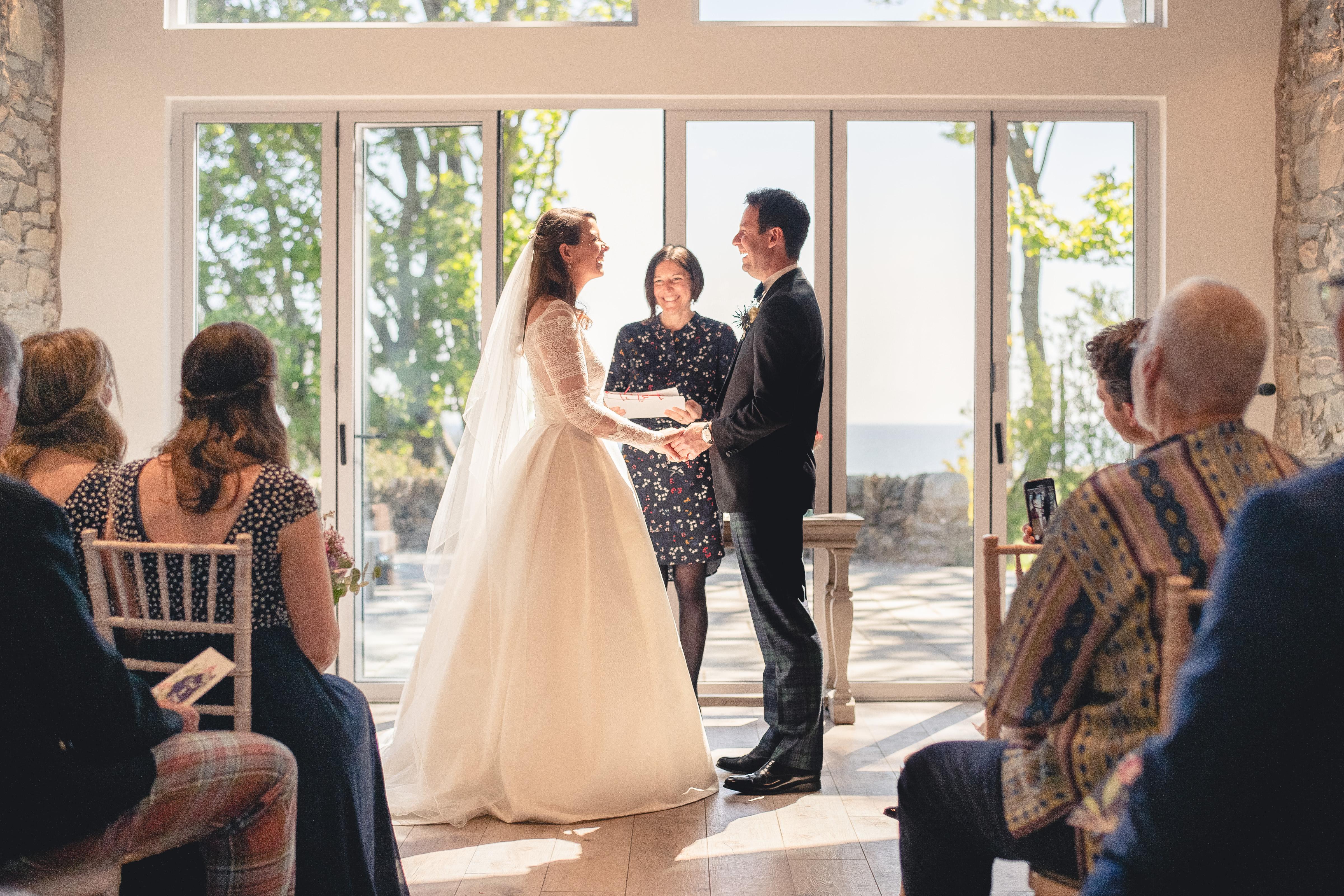 Handfasting Ceremony in Scotland conducted by Wedding Celebrant, Onie Tibbitt.
